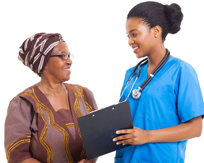 a nurse and a senior woman smiling at each other