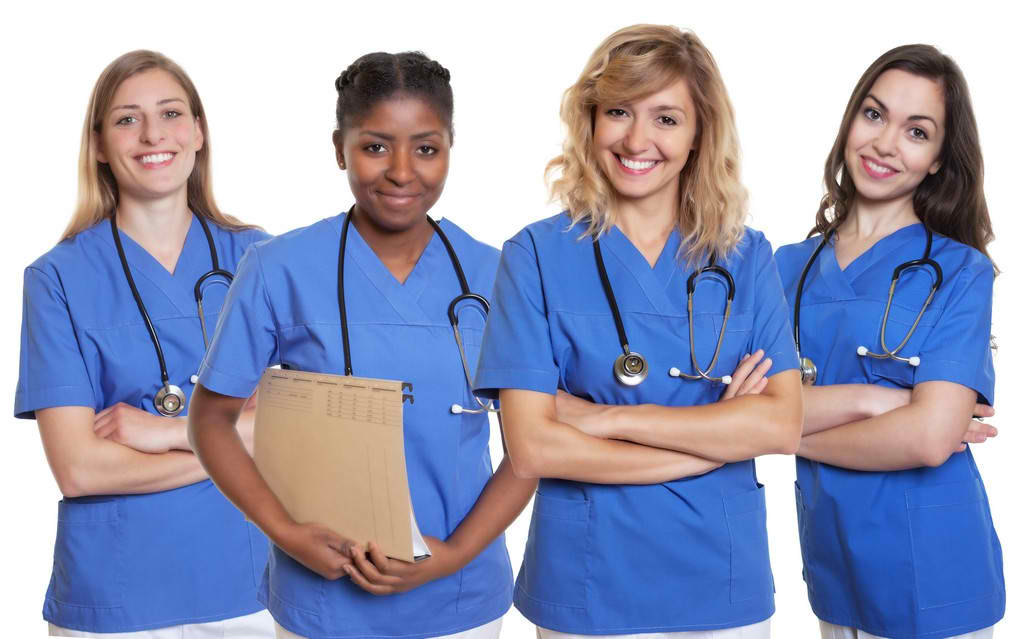 a group of nurses smiling